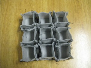 "Nine grey 2"" x 2"" x 2"" felt boxes"
