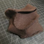 practicing forming one piece of felt and sewing it together to make a 3d form