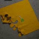 cutting out the shape on some bomb mustard color fabric